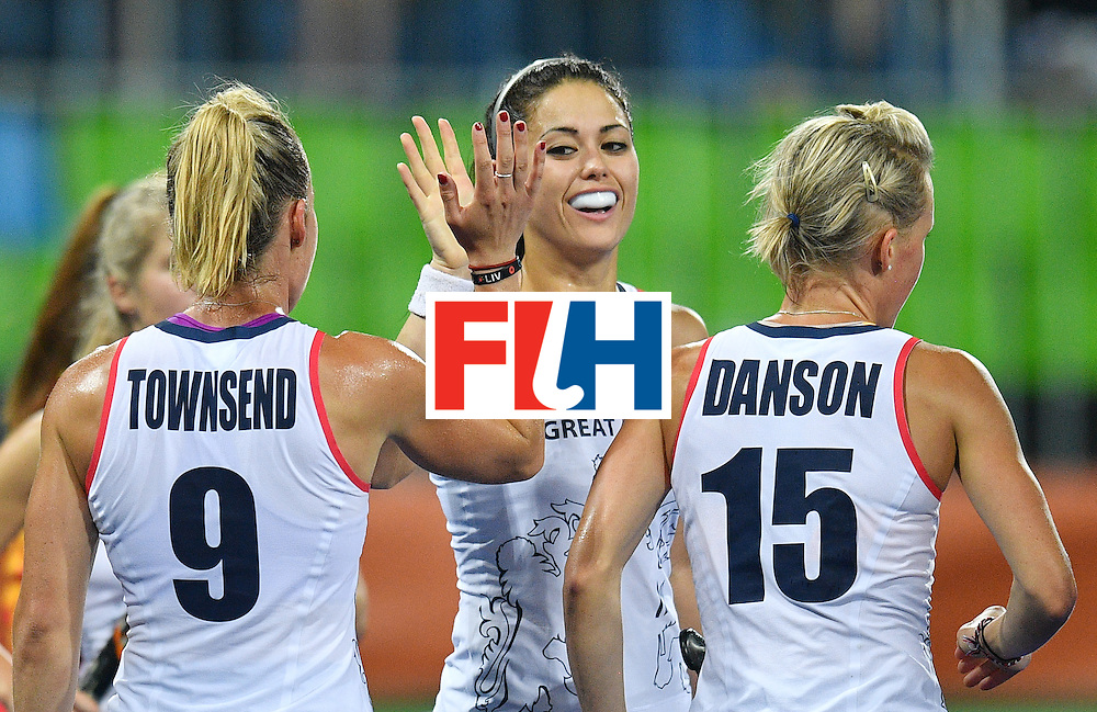 Britain's Sam Quek (C) slaps hands with Britain's Susannah Townsend during the women's quarterfinal field hockey Britain vs Spain match of the Rio 2016 Olympics Games at the Olympic Hockey Centre in Rio de Janeiro on August 15, 2016. / AFP / Carl DE SOUZA        (Photo credit should read CARL DE SOUZA/AFP/Getty Images)
