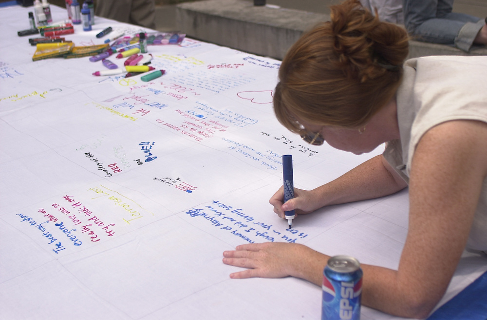 15496Students signing 9/11 Quilt for Memorial Service: Photos: James Patterson
