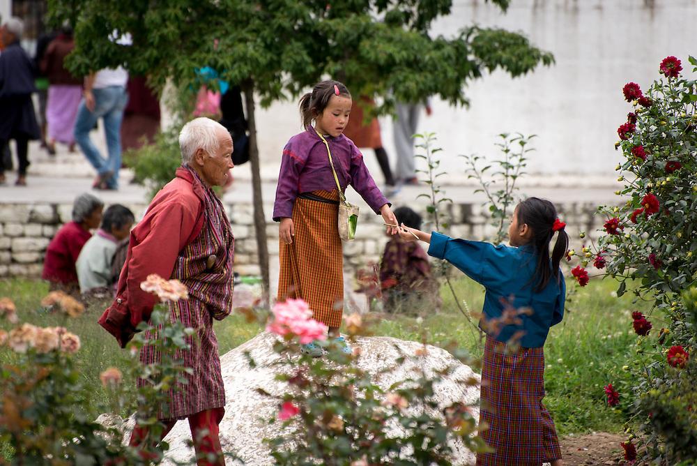 People gathered at a stupa in Thimpu, Bhutan<br /> <br /> Full photoessay at http://xpatmatt.com/photos/bhutan-photos/