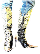 fancy high heel boots with denim jeans on white background