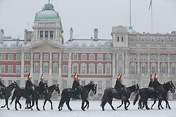 © Licensed to London News Pictures.20_01_2013 LONDON UK.The Blues and Royals, Household Cavalry changing the guard at House Guards Parade.Heavy Snow fall on the third day of  freezing cold weather over most of the country. Photo credit : Andrew Baker/LNP