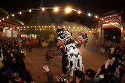 Stock photo of dragon costume dancing during the celebrations for Chinese New Year in downtown Houston Texas