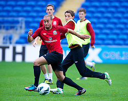 CARDIFF, WALES - Monday, October 15, 2012: Wales' Ashley 'Jazz' Richards and Joe Allen during a training session at the Cardiff City Stadium ahead of the Brazil 2014 FIFA World Cup Qualifying Group A match against Croatia. (Pic by David Rawcliffe/Propaganda)
