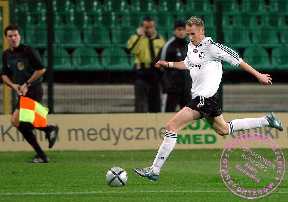 n/z.: Piotr Wlodarczyk (nr9-Legia) podczas meczu Pucharu Polski Legia Warszawa (czarne-biale) - KSZO Ostrowiec Swietkorzyski (pomaranczowe-biale) 2:0 , Puchar Polski , sezon 2005/2006 , pilka nozna , Polska , Warszawa , 26-10-2005 , fot.: Adam Nurkiewicz / mediasport..Piotr Wlodarczyk (nr9-Legia) controls the ball during Polish Cup soccer match in Warsaw. October 26, 2005 ; Legia Warszawa (black-white) - KSZO Otrowiec Swietkorzyski (orange-white) 2:0 ; Polish Cup , season 2005/2006 , football , Poland , Warsaw ( Photo by Adam Nurkiewicz / mediasport )