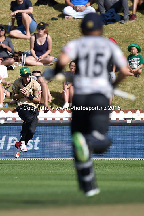 Nathan McCullum (R of the South Island is caught by Adam Milne (L) of the North Island during the North Island vs South Island cricket match at the Basin Reserve in Wellington on Sunday the 28th of February 2016. Copyright Photo by Marty Melville / www.Photosport.nz