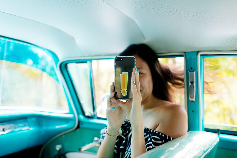 Twenty something takes selfie in 50's car ride in Vinales,Cuba