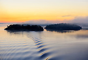 Stockholm Archipelago islands on the Swedish coast on a foggy morning at sunrise as the white night of summer ends.