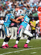 Carolina Panthers middle linebacker Luke Kuechly (59) directs defensive coverage as he pushes Carolina Panthers outside linebacker Chase Blackburn (93) toward the left side during the NFL week 7 football game against the St. Louis Rams on Sunday, Oct. 20, 2013 in Charlotte, N.C.. The Panthers won the game 30-15. ©Paul Anthony Spinelli