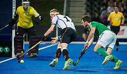 Germany's Chris Ruehr threatens the Irish goal watched by John Jackson. Ireland v Germany - Unibet EuroHockey Championships, Lee Valley Hockey & Tennis Centre, London, UK on 23 August 2015. Photo: Simon Parker