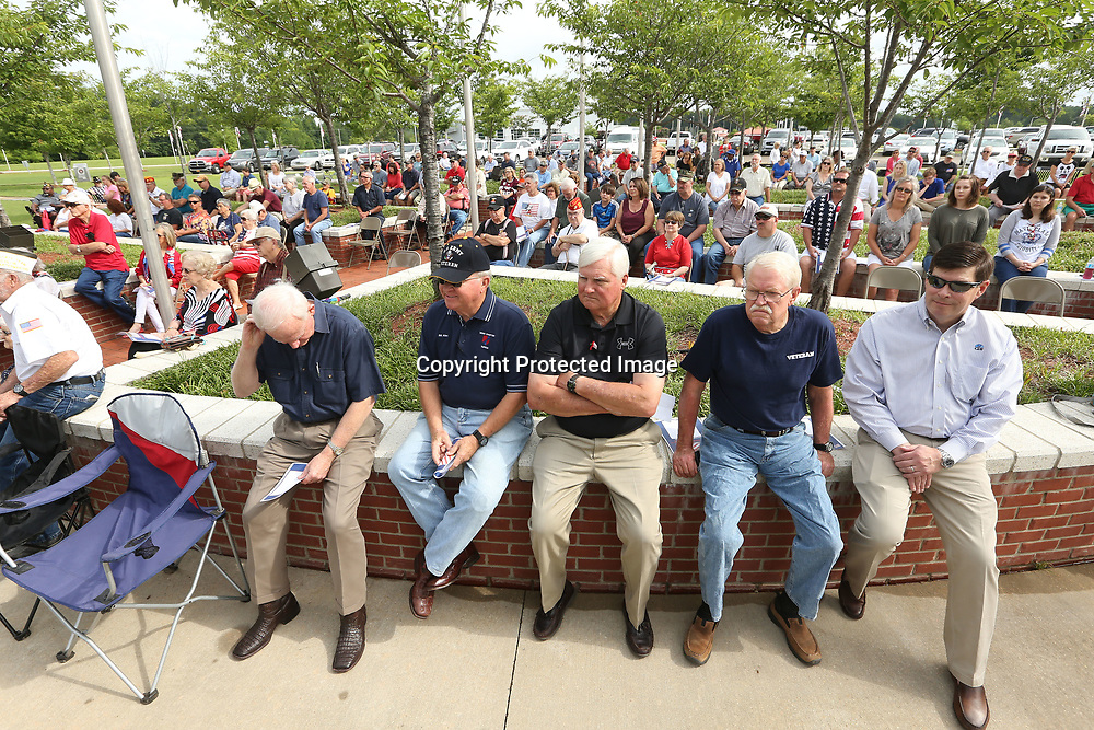 United States Armed Forces Veterans and area residents attend the Memorial Day service held at Veterans Park in Tupelo on Monday morning.