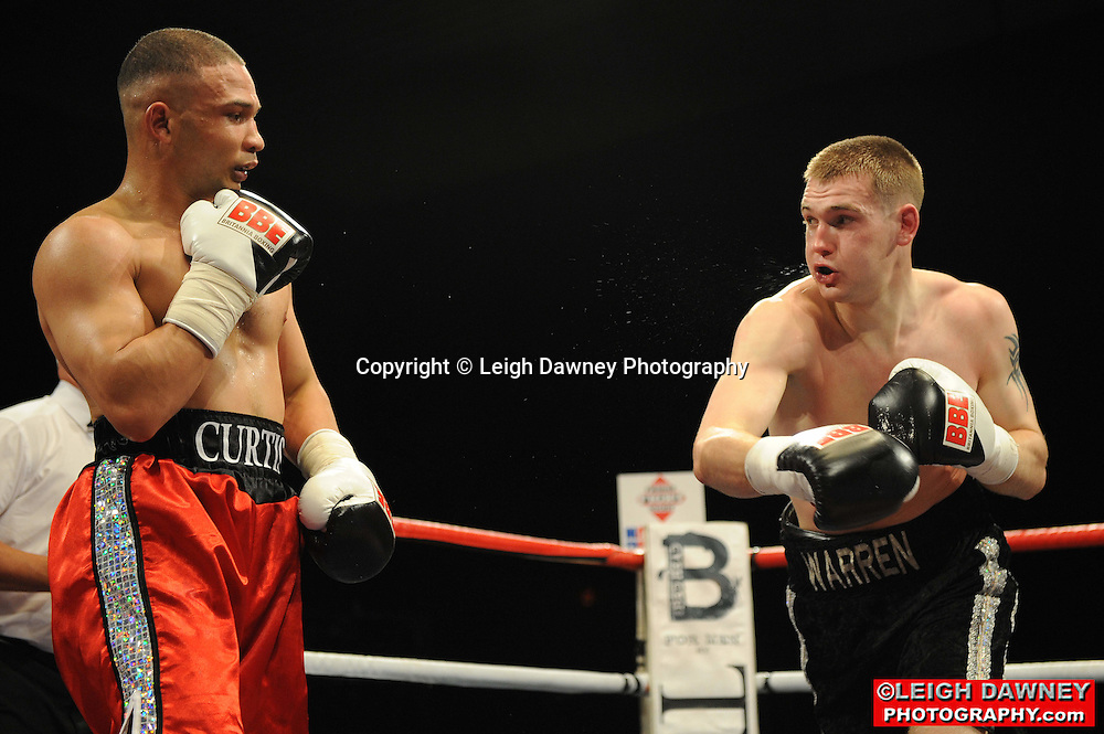 Alastair Warren (black shorts) defeats Curtis Valentine at Huddersfield Leisure Centre on 28th May 2010. Frank Maloney Promotions. Photo credit: © Leigh Dawney