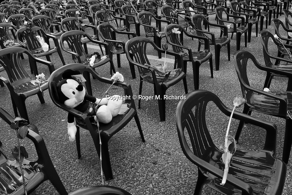A child's Mickey Mouse stuffed toy sits in a chair surrounded by hundreds of empty ones, each representing one of the 1600 children who were killed during the 48 month Bosnian Serb siege of Sarajevo, on April 6, 2012, the 20th anniversary of the beginning of the siege.