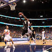 University of Central Florida guard Marcus Jordan (5) drives to the basket while taking on the Florida Gators at the Amway Center on December 1, 2010 in Orlando, Florida. Central Florida won the game 57-54 for their first ever victory against a nationally ranked team. (AP Photo/Alex Menendez)