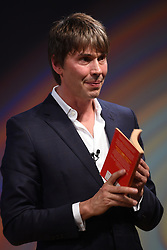 Professor Brian Cox gives a lecture during the Stephen Hawking public symposium at Lady Mitchell Hall in Cambridge.