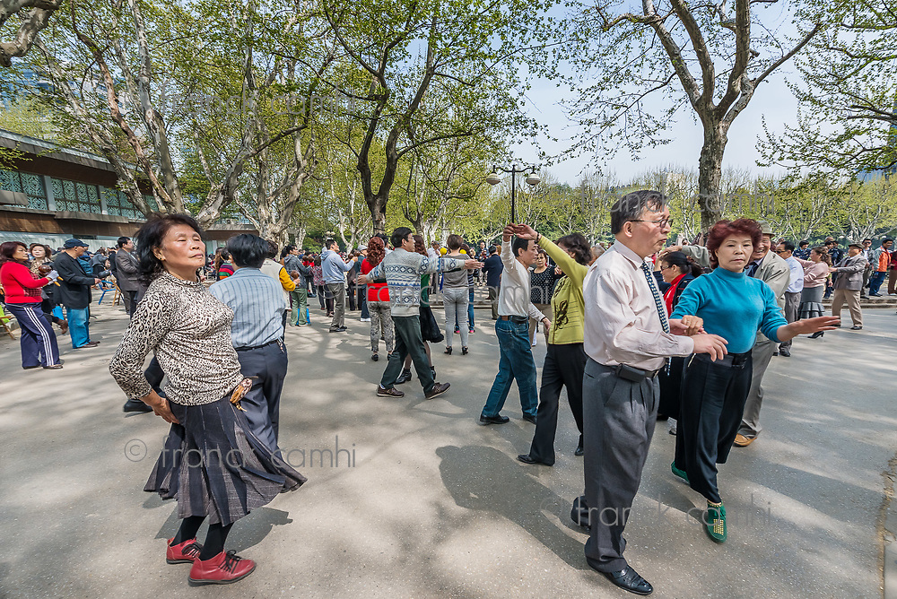 Shanghai, China - April 7, 2013: group of people dancing in fuxing park at the city of Shanghai in China on april 7th, 2013