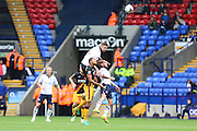 Bolton Wanderers defender Mark Beevers (5) clears the ball over Bradford City midfielder Timothee Dieng (8) and Bolton Wanderers midfielder Jay Spearing (8) during the EFL Sky Bet League 1 match between Bolton Wanderers and Bradford City at the Macron Stadium, Bolton, England on 24 September 2016. Photo by Simon Brady.