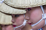 Portraits of women in traditional costume and headwear taking part in the Awa Odori festival in Koenji, Tokyo, Japan. Friday August 24th 2014