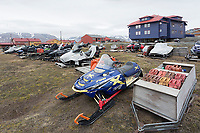 A large number of snowmobiles parked for the summer months reflect the importance of this mode of travel in the winter months.  Longyearbyen, Spitsbergen Island, Svalbard, Norway, Scandinavia.