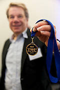 A Top Doctor presents his awarded medal at 417 Magazine's 2015 Top Doctor Event.