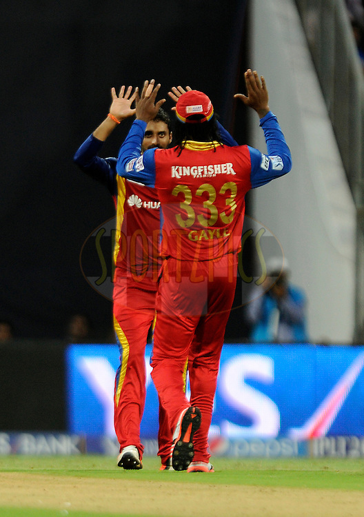 Sreenath Aravind of Royal Challengers Bangalore celebrate the wicket of Kieron Pollard of Mumbai Indians during match 46 of the Pepsi IPL 2015 (Indian Premier League) between The Mumbai Indians and The Royal Challengers Bangalore held at the Wankhede Stadium in Mumbai, India on the 10th May 2015.<br /> <br /> Photo by:  Pal Pillai / SPORTZPICS / IPL