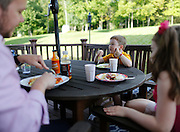 Evan Costik, 6, eats dinner with his family in Livonia, N.Y. on August 27, 2014.<br /> <br /> Evan has type 1 diabetes, and his father, John, modified a continuous glucose monitor and an Android smartphone to provide constant updates on Evan's blood sugar remotely. CREDIT: Mike Bradley for the Wall Street Journal<br /> MEDIHACK