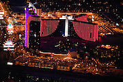 Bright lights are a staple of Las Vegas's booming tourist business.  In 2001 alone, the amount of electricity used to light hotel facades on the Vegas strip could have powered 23,500 homes.