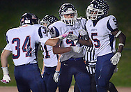 Central Bucks East's Myles King (5) is congratulated by teammates after scoring a touchdown against Council Rock North in the first quarter at Council Rock North Saturday October 15, 2016 in Newtown, Pennsylvania.  (Photo by William Thomas Cain)