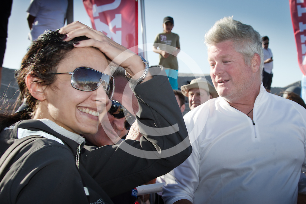 Eliza Gutkowska (wife of Polish skipper Zbigniew Gutkowski) is one of the many to greet American skipper Brad Van Liew after he wins Ocean Sprint Three from Wellington, New Zealand to Punta del Este in Uruguay after 23 days at sea. The VELUX 5 OCEANS is the oldest single-handed round the world yacht race. Run every 4 years since 1982, the race is the longest and toughest event for any individual in any sport. The race is a series of five high-pressure ocean sprints within a marathon circumnavigation. The 30,000 route takes the sailors from La Rochelle FR to Cape Town SA, then onto Wellington NZ, Punta del Este Uruguay, Charleston USA and back to La Rochelle FR, for the finish. For further VELUX 5 OCEANS images go to www.w-w-i.com/velux_5_oceans_2010_race/ .For media enquiries contact: Sarah Hames at: shames@velux5oceans.com or call her on + 44 (0)7813 009 783. For content related enquiries contact info@w-w-i.com on call +44 (0)845 900 2 900. This image is copyright Ainhoa Sanchez/VELUX 5 OCEANS. The author is asserting his full Moral rights in relation to the publication of this image. Rights for onward transmission of this image or file is not granted or implied. Changing or deleting Copyright information is illegal as specified in the Copyright, Design and Patents Act 1988. If you are in any way unsure of your right to publish this image please contact info@w-w-i.com