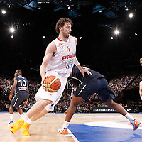 15 July 2012: Pau Gasol of Team Spain drives past Mickael Gelabale of Team France during a pre-Olympic exhibition game won 75-70 by Spain over France, at the Palais Omnisports de Paris Bercy, in Paris, France.