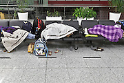 people sleeping on benches at Istanbul Ataturk Airport Turkey