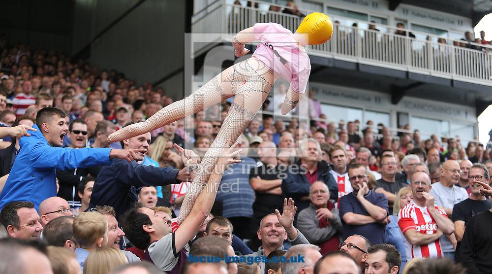 Picture by Richard Calver/Focus Images Ltd +447792 981244<br /> 05/10/2013<br /> Stoke City fans having fun during the Barclays Premier League match against Fulham at Craven Cottage, London.