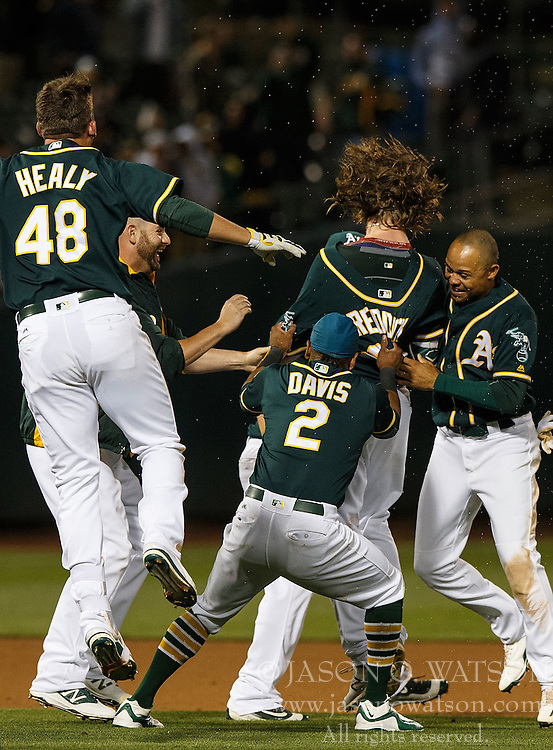 OAKLAND, CA - JULY 19:  Josh Reddick #22 of the Oakland Athletics is congratulated by teammates after hitting a walk off single after the game against the Houston Astros at the Oakland Coliseum on July 19, 2016 in Oakland, California. The Oakland Athletics defeated the Houston Astros 4-3 in 10 innings.  (Photo by Jason O. Watson/Getty Images) *** Local Caption *** Josh Reddick