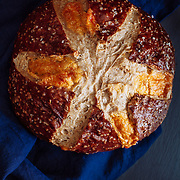 Cheddar Pretzel bread on a indigo linen napkin and black background