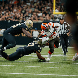 Sep 16, 2018; New Orleans, LA, USA; New Orleans Saints defensive end Alex Okafor (57) tackles Cleveland Browns running back Duke Johnson Jr. (29) during the first quarter of a game at the Mercedes-Benz Superdome. Mandatory Credit: Derick E. Hingle-USA TODAY Sports