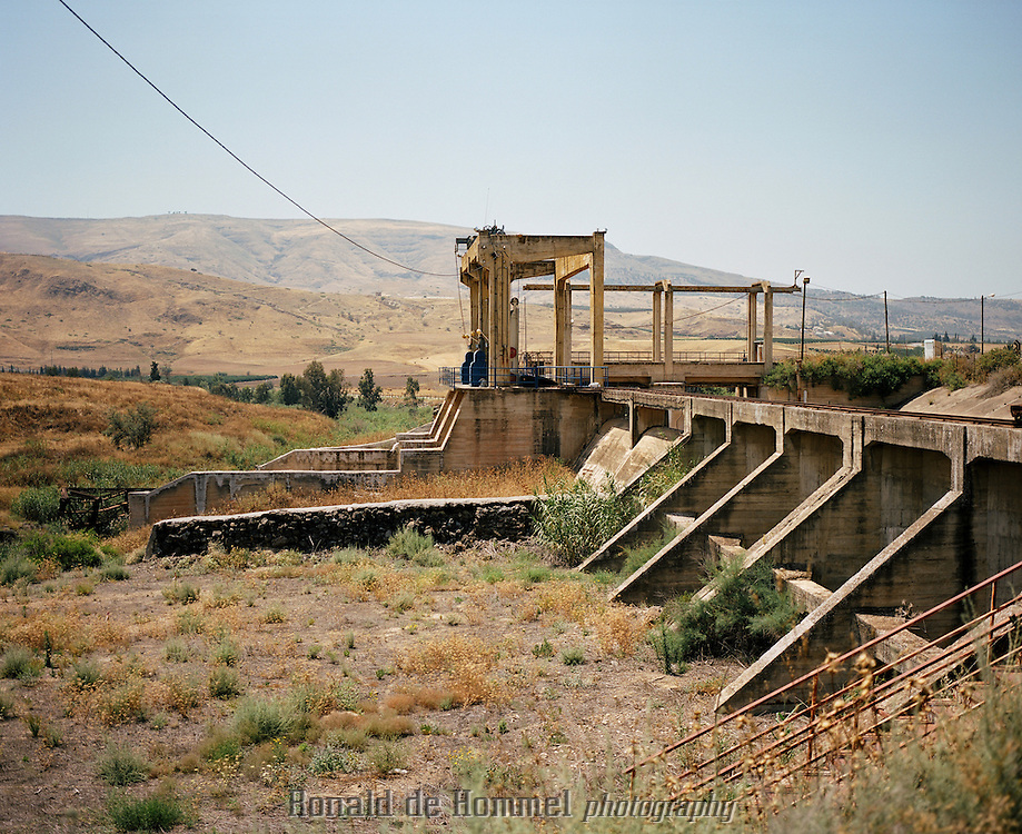 """On the Peace Island or Naharayim at the convergence point between the Yarmouk and Lower Jordan Rivers. The first hydro-electric power station that provided electricity for all of northern Israel was established here in the 1930's. The plant's construction was possible as a result of cooperation between the Jewish engineer Pinhas Rotenberg and King Abdullah I of Jordan. The plant was active and supplying electricity on both sides of the border until the start of the War of Independence in 1948. The region received the name """"Peace Island"""" when Israel and Jordan signed their peace treaty in 1994 in Naharayim. This piece of land is under Jordanian sovereignty, and owned by Kibbutz Ashdot Yaakov, who cultivate the land and promote tourism and local development of the.region."""