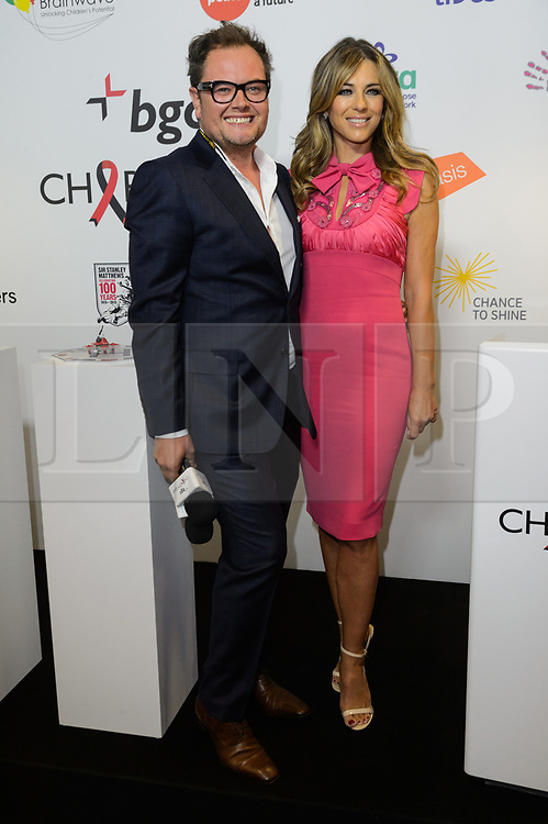 © Licensed to London News Pictures. 11/09/2017. ALAN CARR and ELIZABETH HURLEY takes part in the on the annual BGC Partners Charity Day in commemoration of its 658 friends and colleagues and 61 Eurobroker employees lost in the World Trade Center attacks on 9/11. PIcture Credit: Tang/LNP