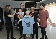 Wayne Sermon, Dan Reynolds, Ben McKee and Daniel Platzman, left to right, of Imagine Dragons, meet with Christian Smith, 4, of Dewey, Okla., and Kate Pierson, 13, of West Jordan, Utah, who have benefitted from the Tyler Robinson Foundation, at Hard Rock Hotel Riviera Maya in Mexico, Tuesday, January 20, 2015, as part of the launch of Hard Rock's Imagine Dragons Signature Series T-shirt and pin.  A portion of the retail price from sales of the merchandise will benefit the foundation supporting families affected by pediatric cancer.  (Photo by Diane Bondareff/Invision for Hard Rock International/AP Images)