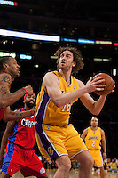 15 January 2010: Forward Pau Gasol of the Los Angeles Lakers turns to shoot while being guarded by Marcus Camby of the Los Angeles Clippers during the second half of the Lakers 126-86 victory over the Clippers at the STAPLES Center in Los Angeles, CA.