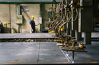SANTA MARIA DEGLI ANGELI (ASSISI), ITALY - 11 JUNE 2018: An oxy fuel cutting machine operated by a worker is seen here as it cuts steel sheets at the IRON S.p.A. factory, a publicly traded company that makes industrial steel parts, in Santa Maria degli Angeli (Assisi), Italy, on June 11th 2018.<br /> <br /> President Donald Trump's administration plans to impose tariffs on European steel and aluminum imports after failing to win concessions from the European Union, a move that could provoke retaliatory tariffs and inflame trans-Atlantic trade tensions. Until the moment that the American president rendered his decision, Mr. Capponi, the commercial director of IRON spa, was confident the continent would be spared.<br /> Given that IRON is a purchaser of steel, the company might benefit from the American tariffs. Steel now shipped to the United States from mills within Europe might stay here to avoid the tariffs, raising the supply and dropping prices. Chinese producers who export to American shores could divert their product to Europe, amplifying this trend.<br /> But Mr. Capponi was banking on none of this. Even if steel prices decline, his customers are likely to squeeze him for lower prices. More broadly, the American tariffs — justified by the Trump administration as a supposed defense of national security — reverberated as a blow against world trade.