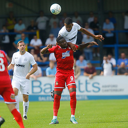 Dovers defender Kevin Lokko wins the ball over Wrexhams forward Mike Fondop during the opening National League match between Dover Athletic and Wrexham FC at Crabble Stadium, Kent on 04 August 2018. Photo by Matt Bristow.