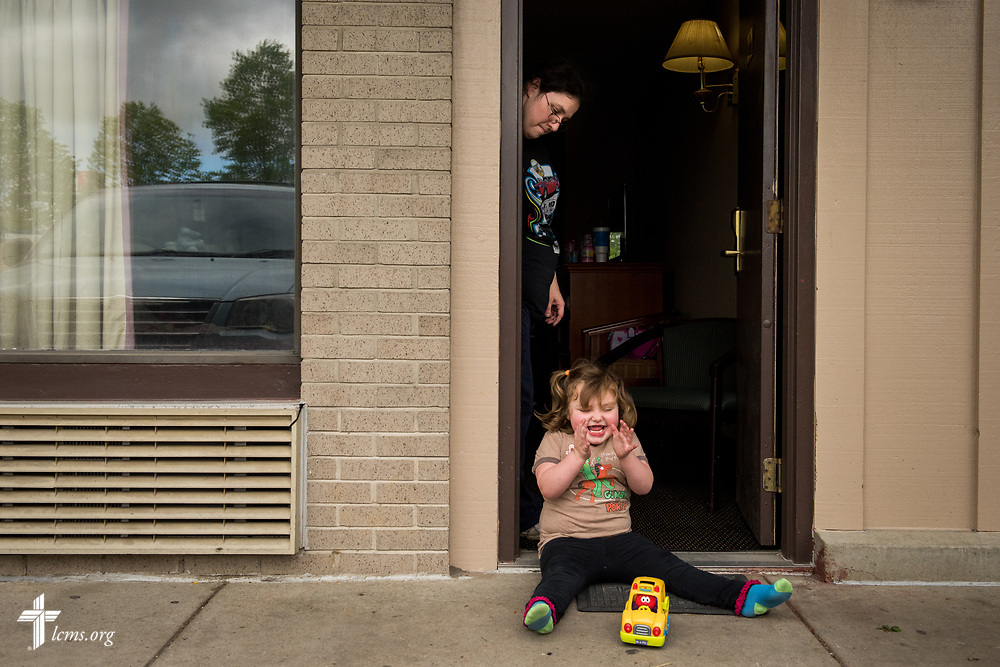 Amanda Prichard watchers her daughter Madalynn play outside a motel on Monday, May 1, 2017, in Eureka, Mo. Local LCMS congregations and LCMS Disaster Response are assisting the Lutheran family who have been displaced due to rising flood waters. LCMS Communications/Erik M. Lunsford