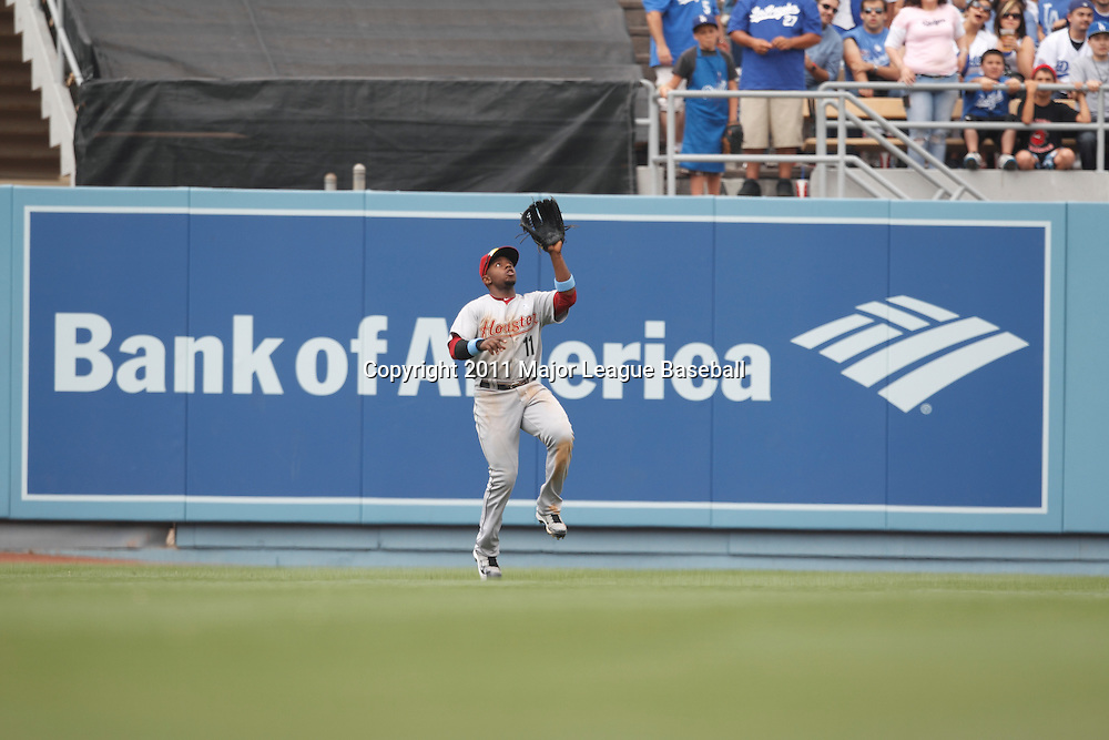 LOS ANGELES - JUNE 19:  Right fielder Jason Bourgeois #11 of the Houston Astros catches a fly ball for the first out in the bottom of the seventh inning during the game against the Los Angeles Dodgers at Dodger Stadium on Sunday, June 19, 2011 in Los Angeles, California.  The Dodgers defeated the Astros 1-0.  (Photo by Paul Spinelli/MLB Photos via Getty Images) *** Local Caption *** Jason Bourgeois