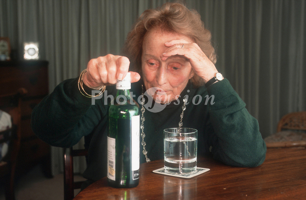 Elderly woman drinking alcohol,