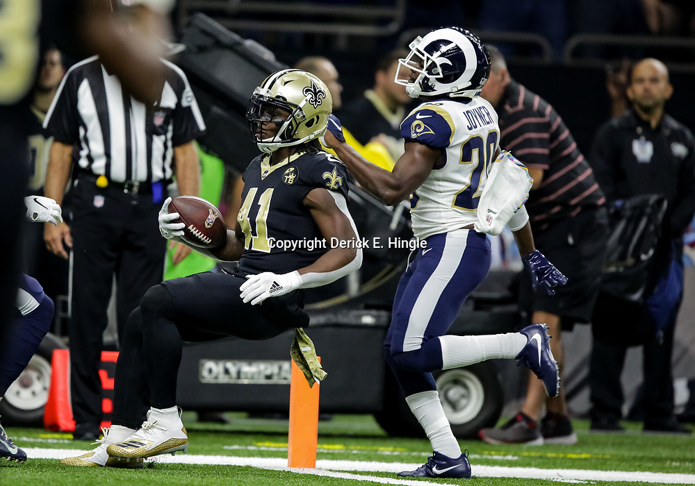 Nov 4, 2018; New Orleans, LA, USA; New Orleans Saints running back Alvin Kamara (41) runs past Los Angeles Rams free safety Lamarcus Joyner (20) for a touchdown during the first half at the Mercedes-Benz Superdome. Mandatory Credit: Derick E. Hingle-USA TODAY Sports