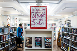 © Licensed to London News Pictures. 01/04/2016. London, UK. A placard sits atop a bookshelf in Herne Hill's Carnegie Library, which is currently occupied by local residents in an effort to prevent its closure. Lambeth Council had planned to close the library last night (31st March) in order to turn it into a 'healthy living centre'. Photo credit : Rob Pinney/LNP