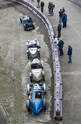 © Licensed to London News Pictures. 28/01/2018. Weybridge, UK. Vintage cars line up on the historic banked track at Brooklands Museum during The Vintage Sports-Car Club's New Year driving tests.  Photo credit: Peter Macdiarmid/LNP