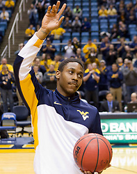 West Virginia Mountaineers guard Juwan Staten (3) waves to the crowd after being honored before Monday's game.