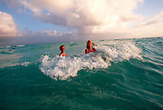 MEXICO, YUCATAN, TOURISM 'Riviera Maya; kids in surf