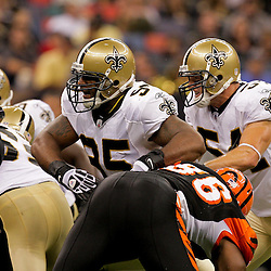 2009 August 14: New Orleans Saints defenders Paul Spicer (95) and Troy Evans (54) rush the Cincinnati Bengals offensive line during a preseason opener between the Cincinnati Bengals and the New Orleans Saints at the Louisiana Superdome in New Orleans, Louisiana.