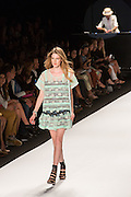 A two-layered dress with black, blue and white under layer in a floral print, and a gauzy light green over layer.